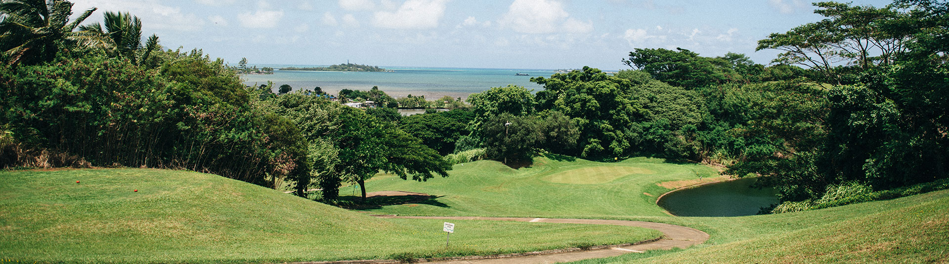 Kaneohe Bay is seen as a backdrop to one of the holes at Bay View Golf Course
